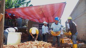 Volunteer-Overseas-in-Indonesia-Batam-Batam-Build-After-Building-Mr-Bahtarim-working-together