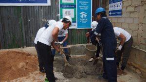 Volunteer Overseas in Indonesia Batam - Batam Build - Mixing Cement-min